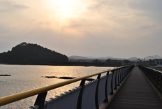 After walking a ways I came to this bridge. As I crossed it I snapped this picture of the setting sun and the hills in the distance. Would I make it to that island thing before the sun went down?