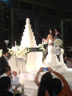 I've never seen a more impressive cake-cutting. The big cake wasn't real though; slices of actual cake were just handed out by the staff.